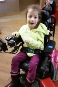 Selin Gurman tries out her new power wheelchair from FODAC